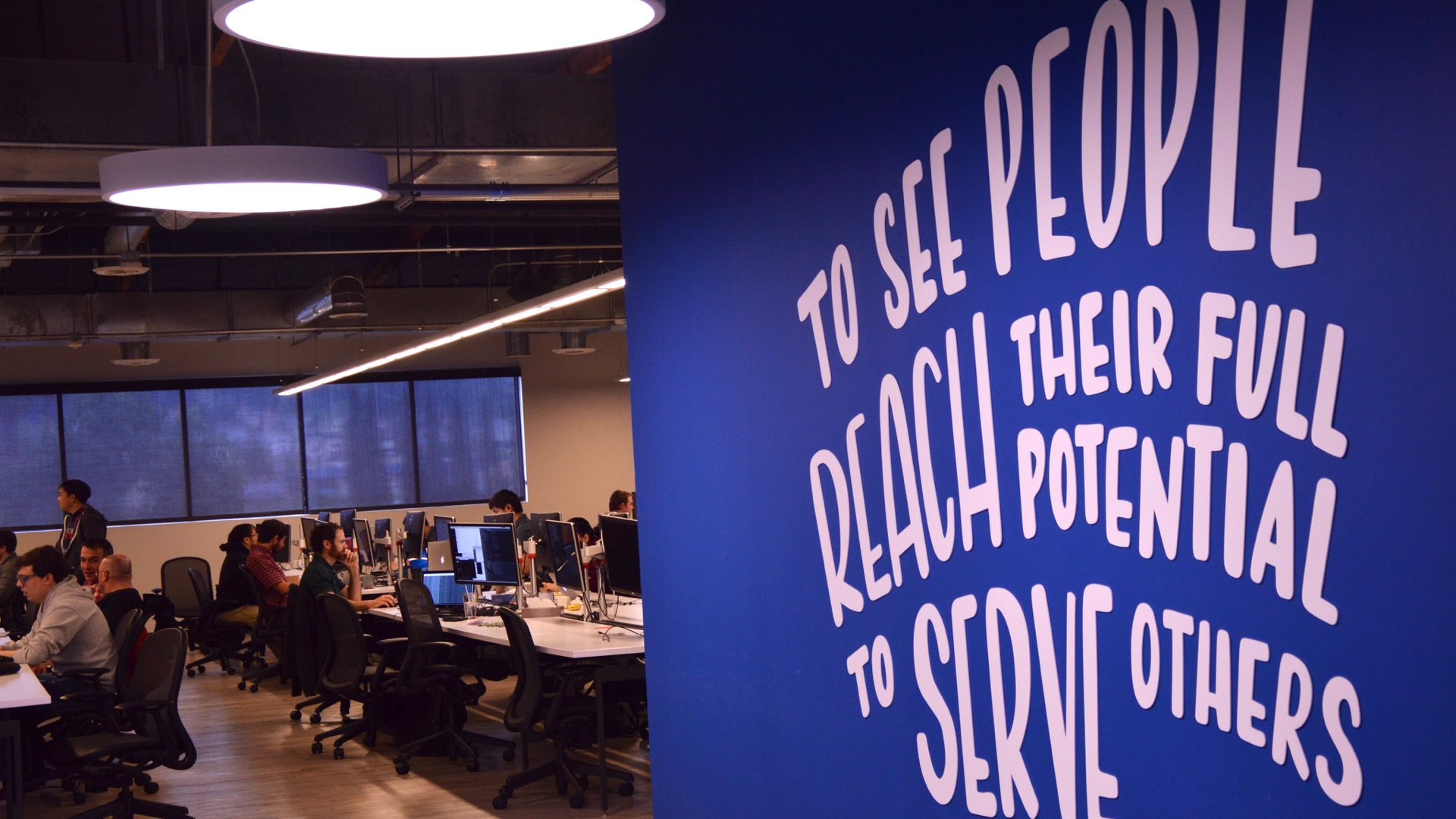 "Liferay's office wall saying ""to see people reach their full potential to serve others"""